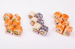 Tres rodillos de sushi Fotos de archivo