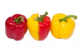 Tres rojos y paprika amarilla (pimiento) Foto de archivo