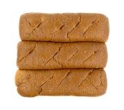 Tres rollos sub del trigo integral en un fondo blanco Foto de archivo libre de regalías