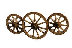 Tres ruedas de madera. Imágenes de archivo libres de regalías