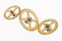 Tres ruedas dentadas de oro viejas Imágenes de archivo libres de regalías