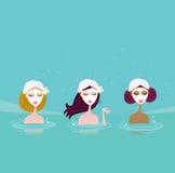 Tres señoras en balneario del agua Fotos de archivo libres de regalías