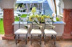 Tres sillas adornadas para una boda Imagenes de archivo