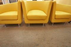 Tres sillas amarillas Imagenes de archivo