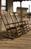 Tres sillas de oscilación vacías del oeste viejas Imagen de archivo libre de regalías