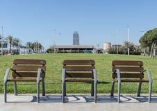 Tres sillas en un paseo Fotografía de archivo