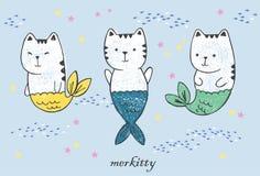 Tres sirenas del gato del animado del kawaii con las colas de los pescados, la multitud de los pescados dibujados con la pluma y  Fotografía de archivo libre de regalías
