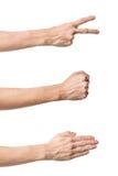 Tres gestos de mano. Juego de papel de las tijeras de la roca Imágenes de archivo libres de regalías