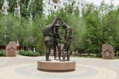Tres soldados con la campana fotos de archivo