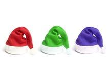 Tres sombreros de Papá Noel Imagenes de archivo