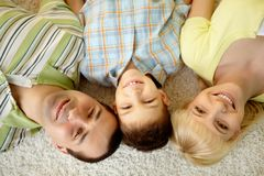 Tres sonrientes Imagen de archivo