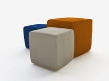 Tres taburetes de cuero suaves en diversos colores Imagenes de archivo