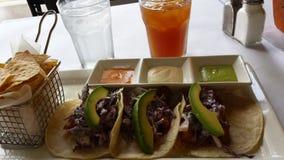 Tres tacos y salsas Fotos de archivo