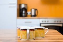Tres tazas anaranjadas Foto de archivo libre de regalías