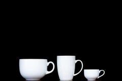 Tres tazas blancas con diversas formas Imagenes de archivo