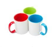 Tres tazas coloreadas Imagenes de archivo