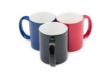Tres tazas coloreadas Fotos de archivo libres de regalías