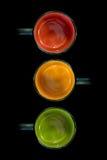 Tres tazas de rojo, de amarillo y de verde Fotografía de archivo libre de regalías