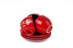 Tres tazas de té rojas chinas en placas Foto de archivo libre de regalías