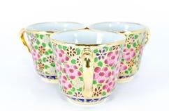 Tres tazas de té tailandesas de oro Imagen de archivo libre de regalías
