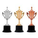 Tres tazas del trofeo en oro, plata y bronce Foto de archivo libre de regalías