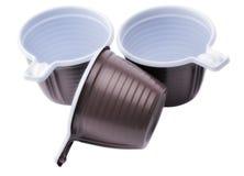 Tres tazas disponibles plásticas marrones Fotografía de archivo libre de regalías