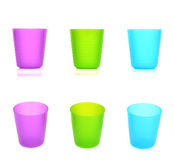 Tres tazas plásticas Fotos de archivo