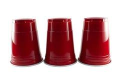 Tres tazas rojas del partido Foto de archivo libre de regalías