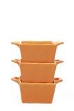 Tres tazones de fuente amarillos vacíos sobre blanco Fotografía de archivo