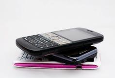 Tres teléfonos móviles Imagen de archivo libre de regalías