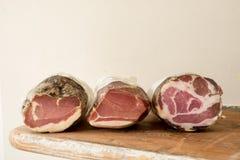Tres tienda de delicatessen o registros curados de la carne Foto de archivo libre de regalías