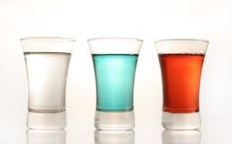 Tres tiros coloridos de la vodka Fotos de archivo libres de regalías