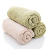 Tres toallas de baño rodadas Imágenes de archivo libres de regalías
