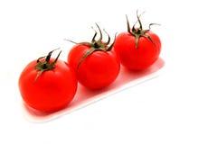 Tres tomates Foto de archivo