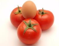 Tres tomates y huevos Imagen de archivo libre de regalías