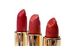 Tres tubos de lápiz labial rojo Fotografía de archivo libre de regalías