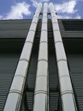 Tres tubos que se levantan altamente en el cielo Imagenes de archivo
