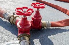 Tres válvulas del agua roja Fotografía de archivo