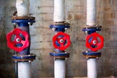 Tres válvulas rojas Fotos de archivo
