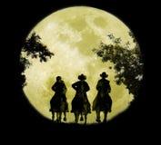 Tres vaqueros bajo salida de la luna ilustración del vector
