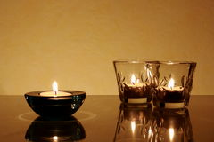Tres veces una vela y una palmatoria Fotos de archivo libres de regalías