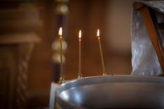 Tres velas de la iglesia Foto de archivo