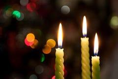 Tres velas en bokeh Fotografía de archivo libre de regalías