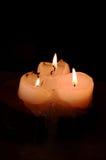 Tres velas en fondo negro foto de archivo