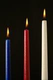 Tres velas encendidas de la cera Foto de archivo libre de regalías