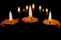 Tres velas y sus reflexiones Imagen de archivo libre de regalías