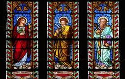 Tres ventanas manchadas vidrio en iglesia Foto de archivo