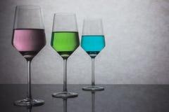 Tres vidrios coloreados de agua Fotos de archivo libres de regalías