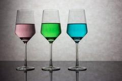 Tres vidrios coloreados de agua Imagen de archivo
