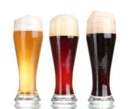 Tres vidrios con diversas cervezas Imágenes de archivo libres de regalías